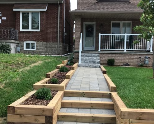 Wooden steps and garden bed.