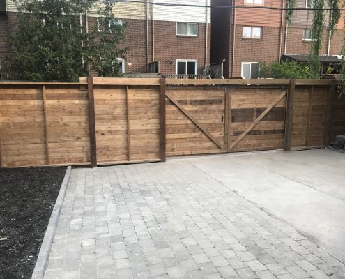 Horizontal fence with rolling gate