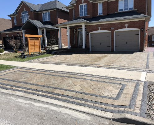Interlocking driveway with double accent border