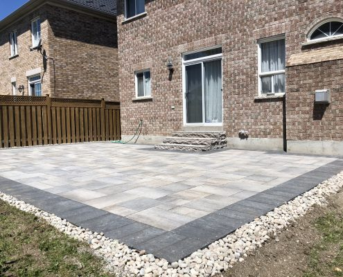 Interlocking patio with natural stone steps